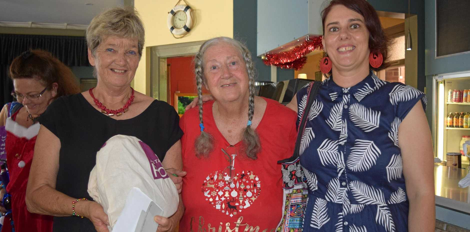 Lismore Soup Kitchen president, Mieke Bell with Healing Voices Choir singers Moppy Chiringchuden and Kim Coleman .