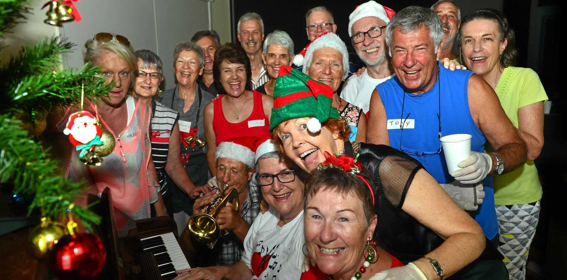 COMMUNITY SPIRIT: Coolum HeARTS volunteers spread the Christmas cheer as they work to prepare a Christmas luncheon for 100 homeless people.