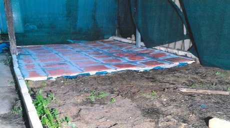 Murder plot covered with tiles in the back yard where Jemma Lilley and Trudi Lennon buried Aaron Pajich. Picture: WA Police.