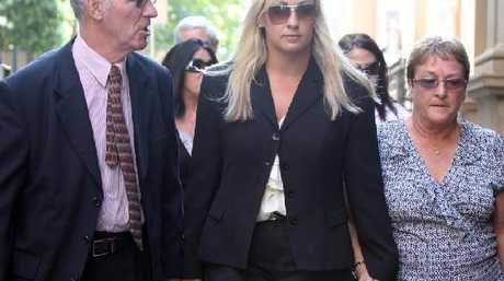Keli Lane (centre) with her parents during her murder trial which resulted in an 18 year sentence for killing her newborn daughter.