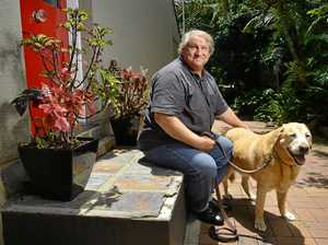 APPEAL: Kelvin Steinhardt missed out on funding for a new guide dog through his original NDIS plan. He is pictured with his retired guide dog Mickey.