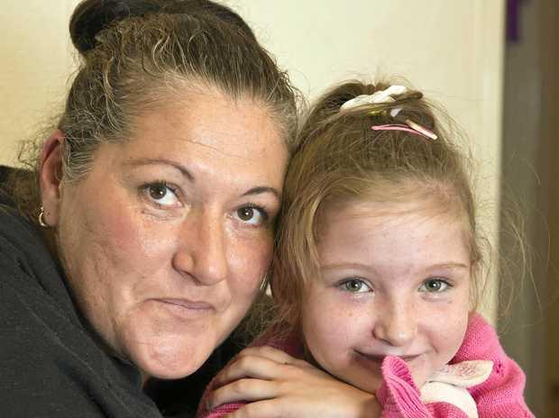 MERRY CHRISTMAS: Sienna Belle (left) and mum Karen Beutel prepare for Sienna's life-saving heart surgery.