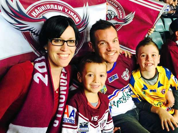 PASSIONATE FANS: Sean Peckover with wife Belinda and sons Hayden and Joel.