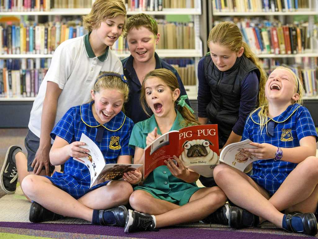 There's too much good stuff to miss out in the books for students (back l-r) Hugh Heyman, Max Rayward, Edyn McDonald (front) Esther Barker, Lila Heyman and Zoe Rayward.