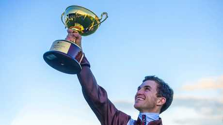 Winning Grafton cup jockey Josh Parr gives a salute to his win on the Grafton Cup and his grandfather.