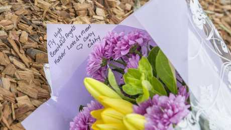 Flowers left the day after the fatal crash at the Manly West scene. Picture: AAP/Richard Walker