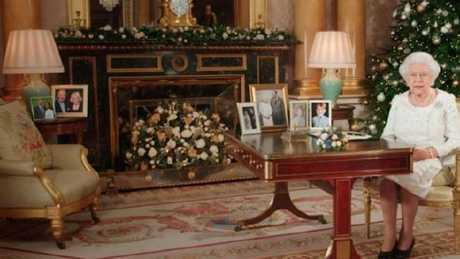 The Queen already has a picture of Harry and Meghan Markle (far left) on her desk. Picture: BBC.