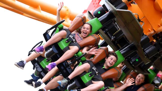Beccy Wilson, 12, and brother Tom, 14, from Gunedah, joins the Boxing Day crowds at Dreamworld. Picture: Adam Head