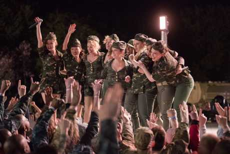 Anna Kendrick, Brittany Snow, Rebel Wilson, Anna Camp, Hana Mae Lee, Hailee Steinfeld, Ester Dean, Kelley Jakle, and Shelley Regner in a scene from Pitch Perfect 3.