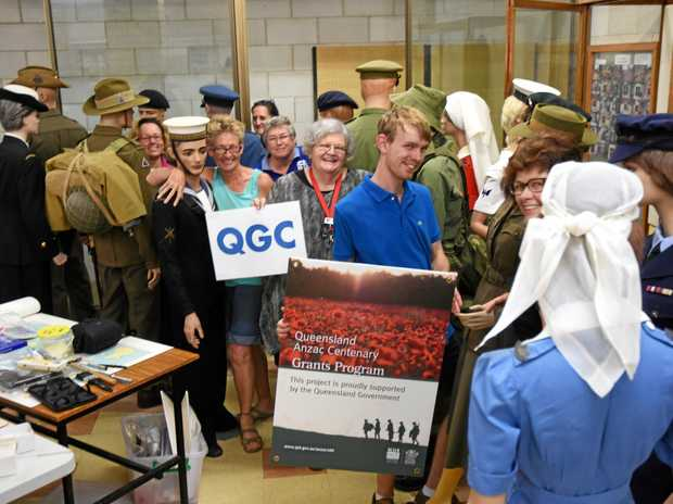 PROJECT IN FULL SWING: Staff and volunteers among the dummy objects of the war museum in Miles.