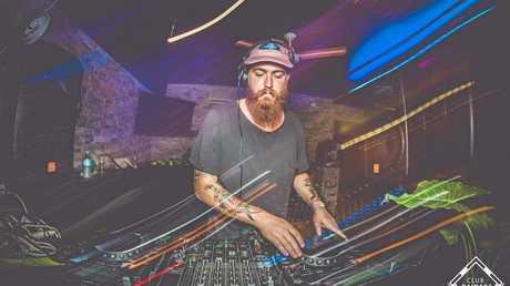 Living his passion: Chris Bradley DJing in Byron Bay.