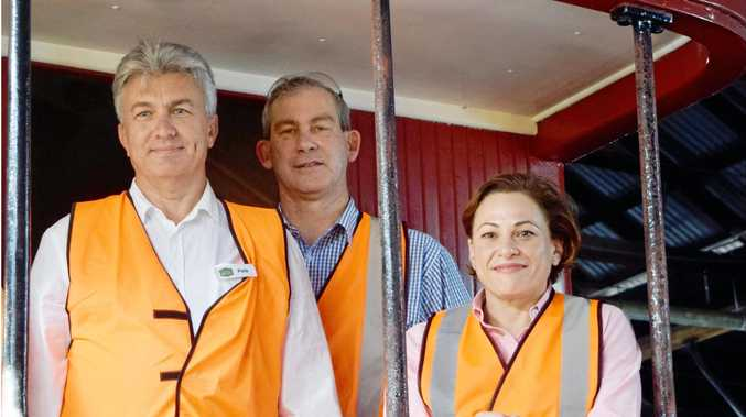 HAPPIER TIMES: Recently resigned Rattler GM Peter Blashki with Mayor Mick Curran and Deputy Premier Jackie Trad at the Rattler workshop.