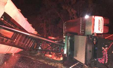 Traffic on the Toowoomba Range came to a standstill after a truck carrying grain rolled, spilling its load.