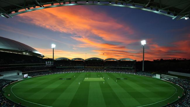 (FILES) This file photo taken on November 24, 2016 shows the sun setting during the day-night third Test cricket match between Australia and South Africa at the Adelaide Oval in Adelaide. Australia will host England at the Adelaide Oval in the first day-night Ashes Test during the 2017-18 series, building on the success of the concept despite lingering concerns. / AFP PHOTO / PETER PARKS / --IMAG
