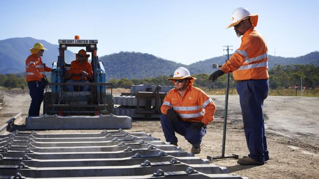Aurizon workers lay track in central Queensland.