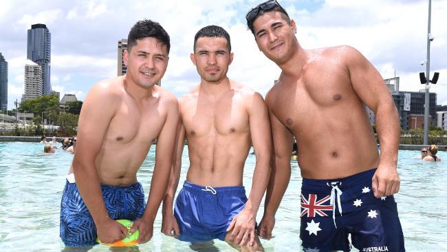 Ghulam Musa Zadah, Mehdi Heidari and Ali Sharifi, all 24, at the Southbank pools. Picture: AAP/John Gass