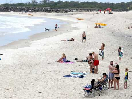 Swimmers returned to Duranbah Beach on Boxing Day after the drowning. Picture:  Mike Batterham