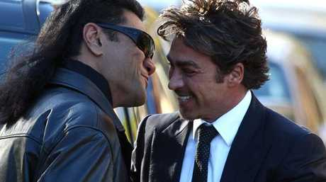 Tongan Sam greets John Ibrahim with a hug and kiss