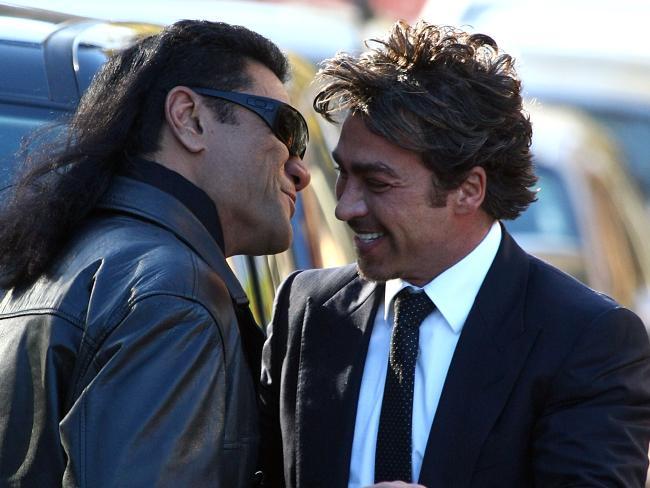Tongan Sam greets John Ibrahim with a hug and kiss