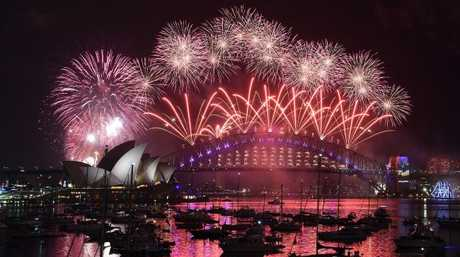 Sydney can expect a few light showers on NYE but they should be gone come fireworks time. Picture: Saeed Khan/AFP