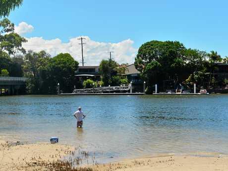 BULL SHARKS: A lone fisherman at Lake Parrearra.