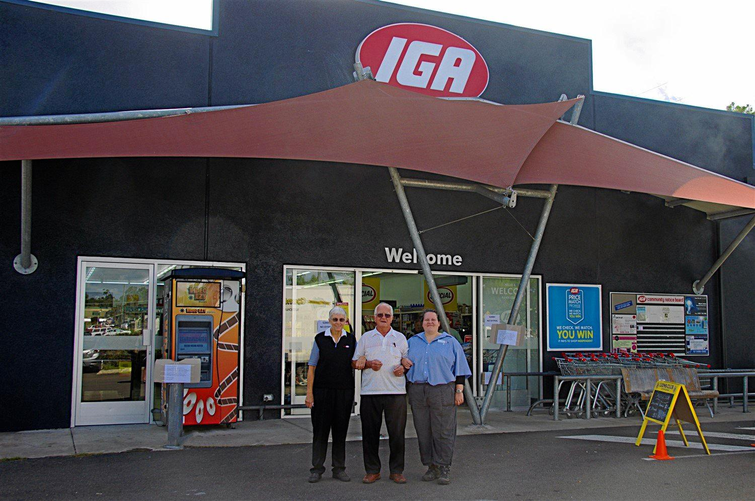 Ruth, Kurt and Diana Steinscherer celebrate the reopening of the Tin Can Bay IGA.