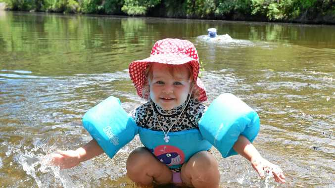 HOT WEATHER: Two-year-old Willow Cahill cools off at the Borumba Camp Grounds yesterday. The Bureau of Meteorology expects the hot and humid conditions to continue into the new year.