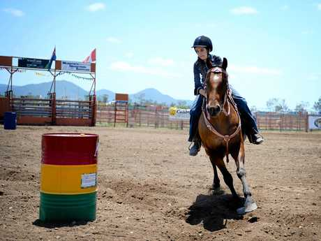 Milly Cogill competing in a barrel race at Gavial Creek Bulls and Barrels. Photo Allan Reinikka / The Morning Bulletin
