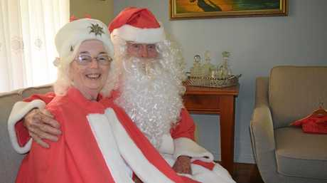 SANTA STEPS DOWN: Bill and Barbara Moore are hanging up their Santa suits after 14 years of fun.