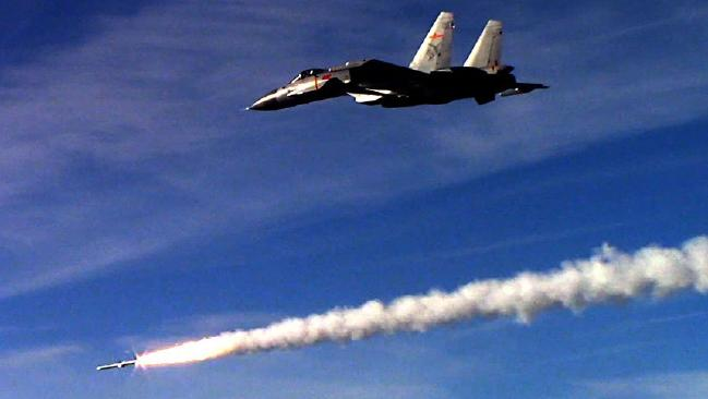 A Chinese fighter test-fires a long-range anti-aircraft missile during exercises earlier this year. Picture: Xinhua