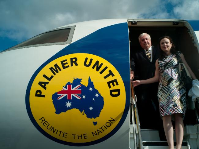 Clive Palmer and wife Anna prepare to alight from the jet while campaigning in Queensland.