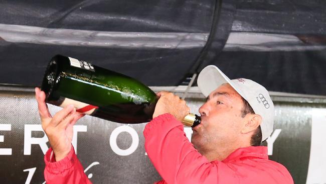 Mark Richards drinks champagne after docking in Hobart. Picture: Richard Jupe