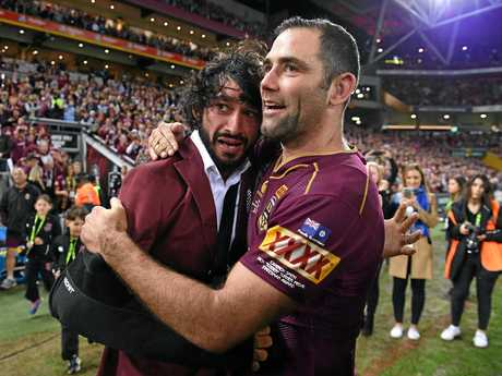 Cameron Smith reacts with an emotional Johnathan Thurston following State of Origin game three.