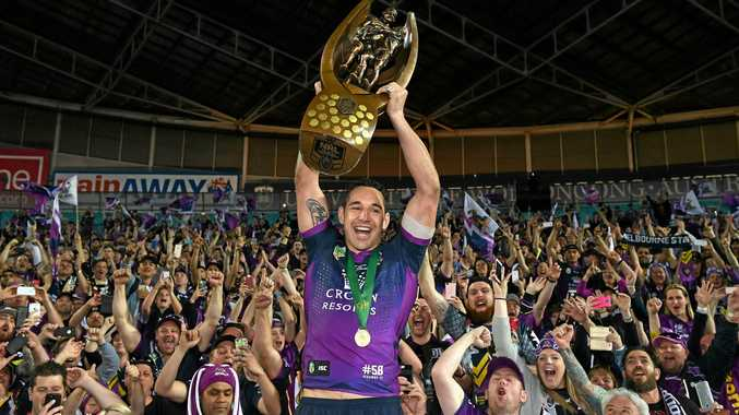 Billy Slater with the NRL trophy after the Storm's grand final win.