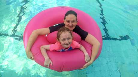 Lillie Gifford with mum Jess cooled off in the pool at the Grafton Aquatic Centre.