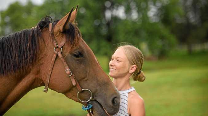 Leah Kilner gives family horse Charlee Bear a cuddle.
