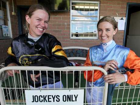 Jockey Nyssa Burrells, who is in an induced coma after a heavy fall this morning, with Tara-Jane Mitchell at Nowra racecourse on Melbourne Cup Day last year.