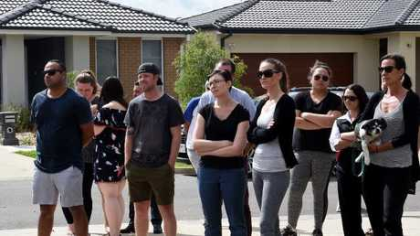 Neighbours watched on while police investigated. Picture: Nicole Garmston. Picture: News Corp Australia
