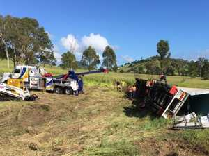 Truckie fights for life after horror Bruce Hwy rollover