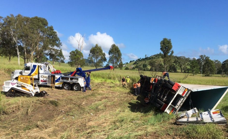 A truckie is trapped on the Bruce Highway after a rollover. Image via 7 News Sunshine Coast