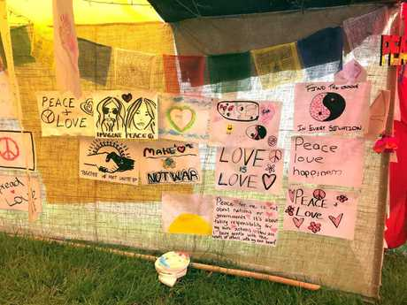 Artwork at the Embedding Peace stall at the Woodford Folk Festival.