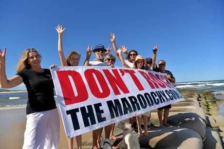 Local residents celebrate the decision not to build a rock wall on the Maroochy River.