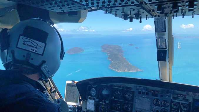 RACQ CQ Rescue en route to Whitehaven Beach to treat and transfer three patients for marine stings.