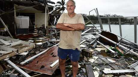 Shute Harbour Motel owner Dave McInnerney stands in the wreckage after Cyclone Debbie destroyed his home and livelihood. Picture: Alix Sweeney