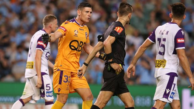 Perth keeper Liam Reddy argues with referee Jonathan Barreiro.