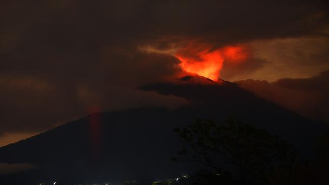 A pre-dawn view shows the erupting Mount Agung volcano in November. Picture: Sonny Tumbelaka