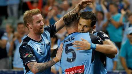 Jordy Buijs and David Carney celebrate with Bobo.