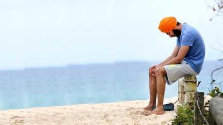 A grief-stricken man mourns the loss of his friend Ravneet Singh Gill at Duranbah Beach. Picture Mike Batterham
