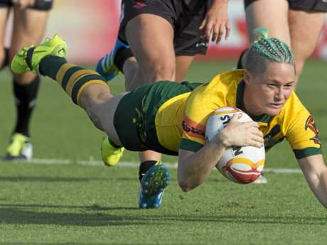 DOMINANT: Chelsea Baker of Australia scores during the Women's Rugby League World Cup match between Australia and Canada.