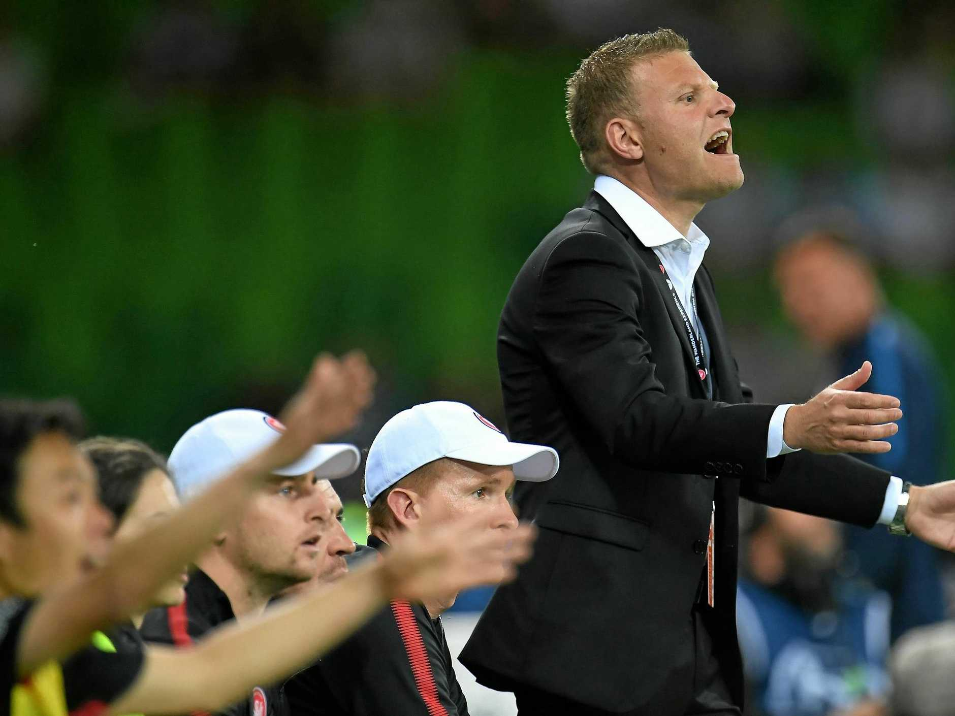 Wanderers coach Josep Gombau (right) urges his players on from the sidelines.